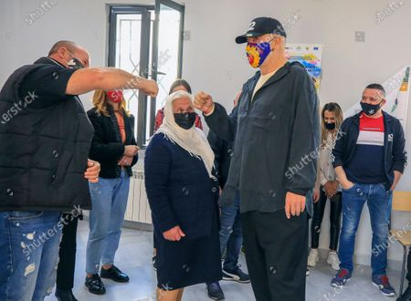 Albania's socialist party leader Edi Rama, foreground right, greets supporters after casting his ballot during parliamentary elections in Surel, near Tirana, . Albanians are voting in parliamentary elections amid the virus pandemic and a bitter political rivalry between the two largest political parties. Some 3.6 million eligible voters, including Albanians overseas, will elect 140 lawmakers among some 1,800 candidates from 12 political parties or coalitions and those running independently