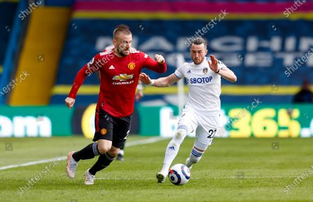 Manchester United defender Luke Shaw (23) and Leeds United midfielder Jack Harrison (22), on loan from Manchester City,  during the Premier League match between Leeds United and Manchester United at Elland Road, Leeds