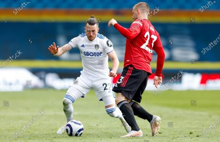Leeds United midfielder Jack Harrison (22), on loan from Manchester City, and Manchester United defender Luke Shaw (23)  during the Premier League match between Leeds United and Manchester United at Elland Road, Leeds