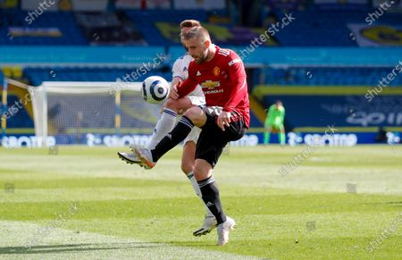 Manchester United defender Luke Shaw (23) controls the ball at the Premier League match between Leeds United and Manchester United at Elland Road, Leeds