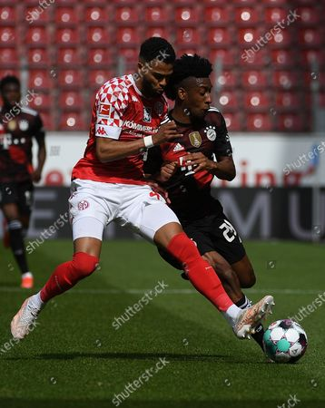 Jeremia St. Juste (FSV Mainz 05) Kingsley Coman (FC Bayern Munich) battle for the ball