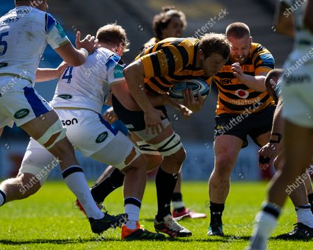 Joe Launchbury of Wasps is wrapped up by the Bath Rugby defence