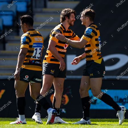 Stock Photo of Josh Bassett of Wasps is congratulated by Michael Le Bourgeois of Wasps after scoring a try- Mandatory by-line: Nick Browning/JMP