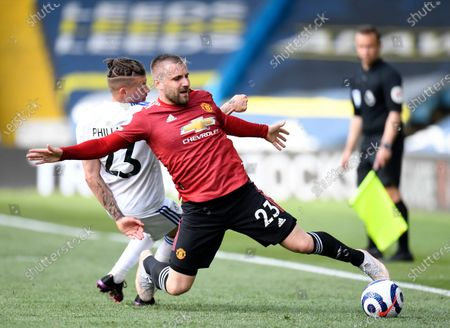 Leeds United's Kalvin Phillips, left, challenges Manchester United's Luke Shaw during the English Premier League soccer match between Leeds United and Manchester United at Elland Road in Leeds, England