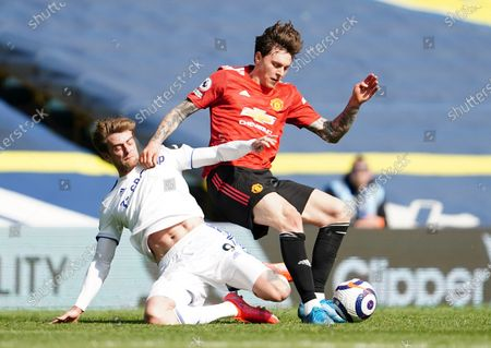 Manchester United's Victor Lindelof is challenged by Leeds United's Patrick Bamford during the English Premier League soccer match between Leeds United and Manchester United at Elland Road in Leeds, England