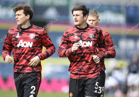 (L-R) Victor Lindelof and Harry Maguire of Manchester United warm up ahead of the English Premier League soccer match between Leeds United and Manchester United in Leeds, Britain, 25 April 2021.