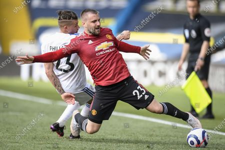 Kalvin Phillips (L) of Leeds in action against Luke Shaw (R) of Manchester United during the English Premier League soccer match between Leeds United and Manchester United in Leeds, Britain, 25 April 2021.