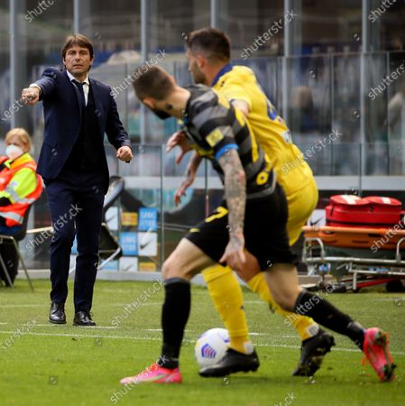 Antonio Conte head coach of FC Internazionale gestures during the Serie A match between FC Internazionale and Hellas Verona FC at Stadio Giuseppe Meazza on April 25, 2021 in Milan, Italy. Sporting stadiums around Italy remain under strict restrictions due to the Coronavirus Pandemic as Government social distancing laws prohibit fans inside venues resulting in games being played behind closed doors.