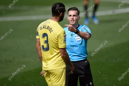 Raul Albiol of Villarreal CF with the referee of the match
