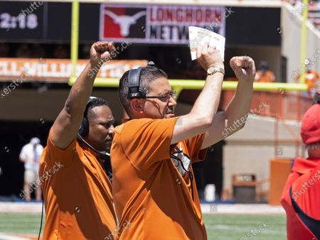 Texas assistant head coach Jeff Banks signals during the first half of the Texas Orange and White Spring Scrimmage in Austin, Texas
