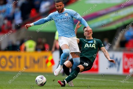 Tottenham's Giovani Lo Celso tackles Manchester City's Kyle Walker, left, during the English League Cup final soccer match between Manchester City and Tottenham Hotspur at Wembley stadium in London