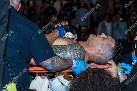Stock Image of Chris Weidman leaves the octagon on a stretcher after a UFC 261 mixed martial arts fight, in Jacksonville, Fla. This is the first UFC event since the onset of the COVID-19 pandemic to feature a full crowd in attendance