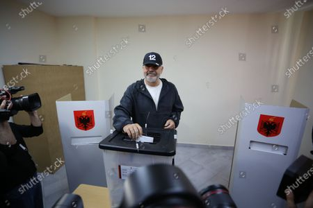 (210425) - TIRANA, April 25, 2021 (Xinhua) - Edi Rama, leader of the ruling Socialist Party and prime minister of the country for two mandates, casts his ballot during the parliamentary elections at a polling station in Tirana, capital of Albania, on April 25, 2021. Parliamentary elections kicked off across Albania on Sunday amid the COVID-19 pandemic.