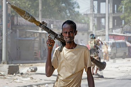 Soldier supporting anti-government opposition groups carries a rocket-propelled grenade launcher on a street in the Fagah area of Mogadishu, Somalia . Gunfire was exchanged Sunday between government forces loyal to President Mohamed Abdullahi Mohamed, who signed into law on April 14 a two year extension of his mandate and that of his government, and other sections of the military opposed to the move and sympathetic to former presidents Hassan Sheikh Mohamud and Sharif Sheikh Ahmed