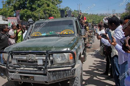 Military forces supporting anti-government opposition groups drive on a street in the Fagah area of Mogadishu, Somalia . Gunfire was exchanged Sunday between government forces loyal to President Mohamed Abdullahi Mohamed, who signed into law on April 14 a two year extension of his mandate and that of his government, and other sections of the military opposed to the move and sympathetic to former presidents Hassan Sheikh Mohamud and Sharif Sheikh Ahmed