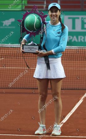 Stock Photo of Sorana Cirstea of Romania poses with her first place trophy following her final match against Elise Mertens of Belgium at the TEB BNP Paribas Tennis WTA Istanbul Championships in Istanbul, Turkey, 25 April 2021.