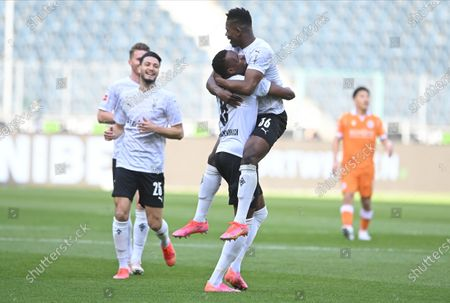 Moenchengladbach's Breel Embolo (R) celebrates with teammate Denis Zakaria (C) after scoring the 1-0 lead during the German Bundesliga soccer match between Borussia Moenchengladbach and Arminia Bielefeld in Moenchengladbach, Germany, 25 April 2021.