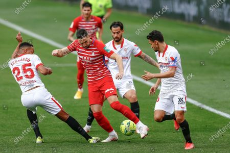 Antonio Puertas and Carlos Neva of Granada CF and Jesus Joaquin Fernandez Suso, Jesus Navas and Fernando Reges of Sevilla FC