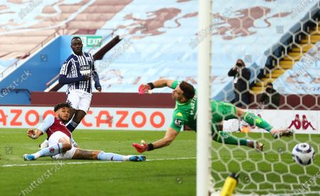 West Bromwich Albion's Mbaye Diagne scores his side's second goal during the English Premier League soccer match between Aston Villa and West Bromwich Albion at Villa Park Stadium in Birmingham, England