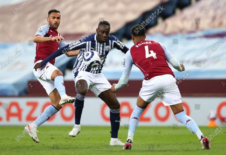 Aston Villa's Ahmed Elmohamady, left, Aston Villa's Ezri Konsa, right, and West Bromwich Albion's Mbaye Diagne challenge for the ball during the English Premier League soccer match between Aston Villa and West Bromwich Albion at Villa Park Stadium in Birmingham, England