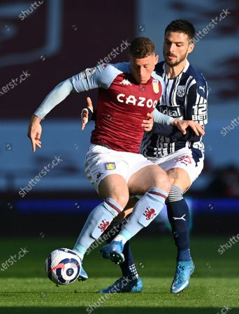 Aston Villa's Ross Barkley, left, and West Bromwich Albion's Okay Yokuslu challenge for the ball during the English Premier League soccer match between Aston Villa and West Bromwich Albion at Villa Park Stadium in Birmingham, England