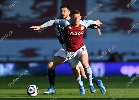 Aston Villa's Ross Barkley, right, and West Bromwich Albion's Okay Yokuslu challenge for the ball during the English Premier League soccer match between Aston Villa and West Bromwich Albion at Villa Park Stadium in Birmingham, England