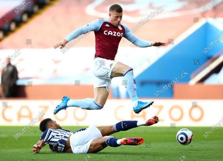 West Bromwich Albion's Darnell Furlong, bottom, and Aston Villa's Ross Barkley challenge for the ball during the English Premier League soccer match between Aston Villa and West Bromwich Albion at Villa Park Stadium in Birmingham, England