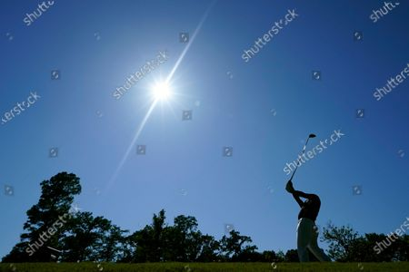 Louis Oosthuizen, of South Africa, hits off the 16th tee during the final round of the PGA Zurich Classic golf tournament at TPC Louisiana in Avondale, La