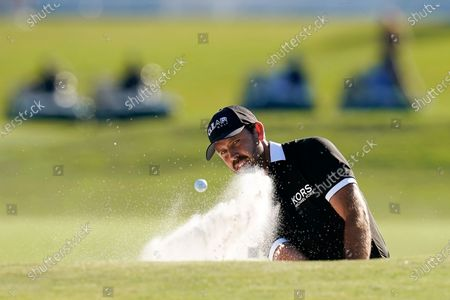 Louis Oosthuizen, of South Africa, hits out of a bunker onto the 18th green during the final round of the PGA Zurich Classic golf tournament at TPC Louisiana in Avondale, La