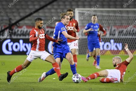 Stock Image of Standard's Mehdi Carcela, Genk's Kristian Thorstvedt and Standard's Nicolas Raskin fight for the ball during the 'Croky Cup' Belgian cup final between KRC Genk and Standard de Liege, Sunday 25 April 2021 in Brussels.