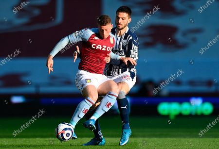 Aston Villa's Ross Barkley (L) in action against West Bromwich's Okay Yokuslu (R) during the English Premier League soccer match between Aston Villa and West Bromwich Albion in Birmingham, Britain, 25 April 2021.