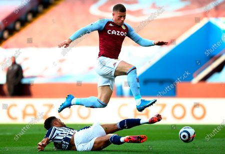 Aston Villa's Ross Barkley (up) in action against West Bromwich's Darnell Furlong (bottom) during the English Premier League soccer match between Aston Villa and West Bromwich Albion in Birmingham, Britain, 25 April 2021.