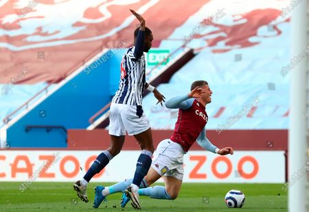 Aston Villa's Ross Barkley (R) is fouled by West Bromwich's Semi Ajayi (L) during the English Premier League soccer match between Aston Villa and West Bromwich Albion in Birmingham, Britain, 25 April 2021.