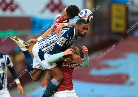 West Bromwich's Semi Ajayi (C) in action against Aston Villa players Matt Targett (R) and Bertrand Traore (L) during the English Premier League soccer match between Aston Villa and West Bromwich Albion in Birmingham, Britain, 25 April 2021.