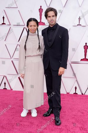 Chloe Zhao, left, and Joshua James Richards arrive at the Oscars, at Union Station in Los Angeles