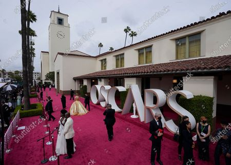 Viola Davis, from left, and Julius Tennon are interviewed while Carey Mulligan walks the red carpet at the Oscars, at Union Station in Los Angeles
