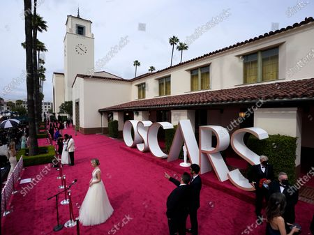 Viola Davis, from left, Julius Tennon and Maria Bakalova are interviewed on the red carpet at the Oscars, at Union Station in Los Angeles