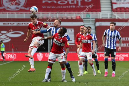 Paddy McNair of Middlesbrough in action with Jordan Rhodes of Sheffield Wednesday and Neeskens Kebano  during the Sky Bet Championship match between Middlesbrough and Sheffield Wednesday at the Riverside Stadium, Middlesbrough on Saturday 24th April 2021.