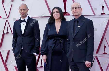 Jesse Collins, from left, Stacey Sher, and Steven Soderbergh arrive at the Oscars, at Union Station in Los Angeles