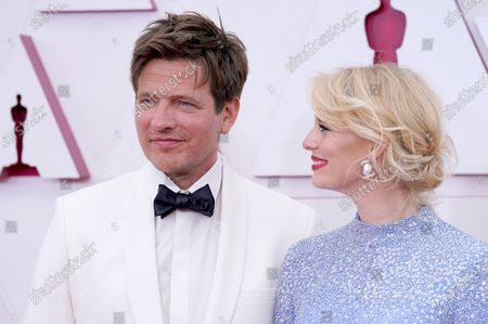 Thomas Vinterberg, left, and Helene Reingaard Neumann arrive at the Oscars, at Union Station in Los Angeles