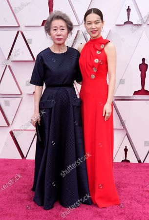 Youn Yuh-jung, left, and Han Ye-ri arrive at the Oscars, at Union Station in Los Angeles