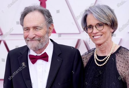 Eric Roth, left, and Debra Greenfield arrive at the Oscars, at Union Station in Los Angeles