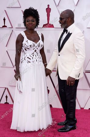 Viola Davis, left, and Julius Tennon arrive at the Oscars, at Union Station in Los Angeles
