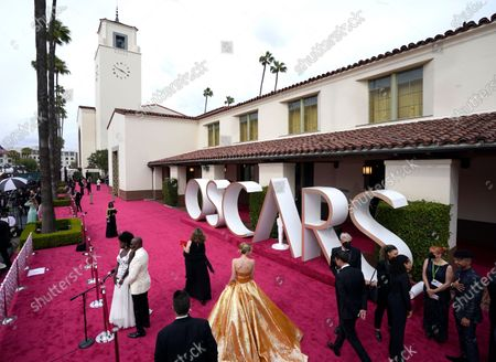 Viola Davis, from left, and Julius Tennon are interviewed while Carey Mulligan, center, walks the red carpet at the Oscars, at Union Station in Los Angeles