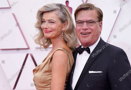 Paulina Porizkova, left, and Aaron Sorkin arrive at the Oscars, at Union Station in Los Angeles