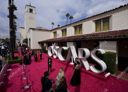 Nicolette Robinson, from left, Leslie Odom Jr., Youn Yuh-jung, Han Ye-ri and Emerald Fennell walk the red carpet at the Oscars, at Union Station in Los Angeles