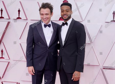 Stock Image of Ben Proudfoot, left, and Kris Bowers arrive at the Oscars, at Union Station in Los Angeles