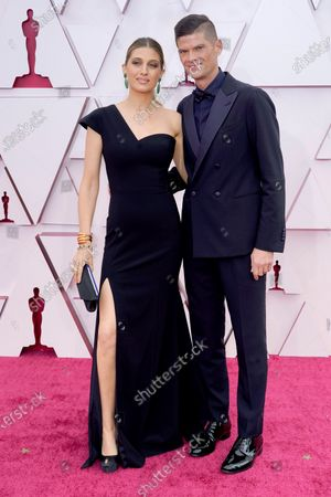 Emily Arlook, left, and Will McCormack arrive at the Oscars, at Union Station in Los Angeles