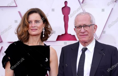 Sophie Newton, left, and James Newton Howard arrive at the Oscars, at Union Station in Los Angeles