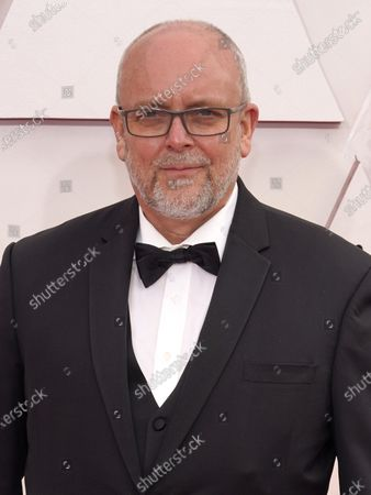 Stock Photo of Mark Coulier arrives for the 93rd annual Academy Awards ceremony at Union Station in Los Angeles, California, USA, 25 April 2021. The Oscars are presented for outstanding individual or collective efforts in filmmaking in 24 categories. The Oscars happen two months later than originally planned, due to the impact of the coronavirus COVID-19 pandemic on cinema.